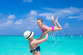 Mother with her cute daughter enjoy the holiday and having fun in water — Stock Photo