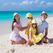 Young family with two kids at tropical white beach — Stock Photo
