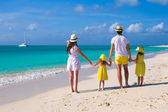 Young family of four on caribbean vacation — Stock Photo