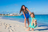Happy little girl have fun at beach during caribbean vacation — Stock Photo