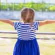Little cute girl looking over the river from luxury ship — Stock Photo #46179725