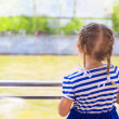 Little cute girl looking over the river from luxury ship — Stock Photo #46179889