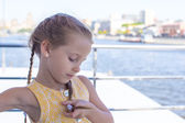 Little girl sailing on a big ship in the city — Stock Photo