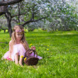 Portrait of adorable little girl in blossoming apple orchard — Stock Photo #46678607