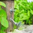 Close up outdoor beach shower at exotic resort — Stock Photo #46679235