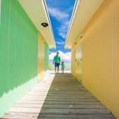 Father with little daughter walking on caribbean island — Stock Photo