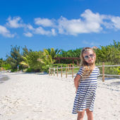 Cute little girl in sunglasses at beach during summer vacation — Foto de Stock