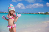 Little adorable girl on tropical beach — Stock Photo