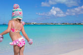 Back view of little adorable girl enjoying caribbean vacation — Stock Photo