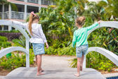 Little adorable girls in a beautiful exotic hotel — Foto de Stock