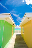 Bright colored houses on an exotic Caribbean island — Stock Photo