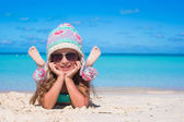 Portrait of adorable little girl on summer vacation at white beach — Stock Photo