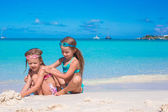 Adorable little girls in swimsuit and glasses for swimming at tropical beach — Stock Photo