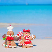 Close up of Christmas gingerbread cookies on a white sandy beach — Stock Photo