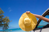 Close up of yellow hat on the car at caribbean island — Stock Photo