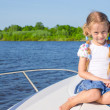 Little girl sailing on a luxury yacht — Stock Photo