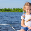 Little girl relaxing on a luxury yacht — Stock Photo