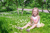 Little happy girl picking flowers in green glade — 图库照片