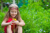 Little cute girl with dandelion in the garden — Stock Photo