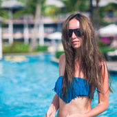 Portrait of young beautiful woman in the pool — Stock Photo