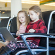 Kids with a laptop at the airport while waiting his flight — Stock Photo #47865435
