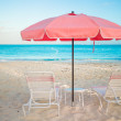 Two chairs and umbrella on stunning tropical beach — Stock Photo #47900621