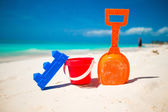 Summer kids beach toy in the white sand — Stock Photo