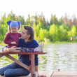 Young dad and little girl fishing on the lake — Stock Photo #48424547