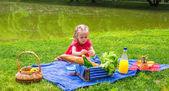 Adorable little girl on picnic outdoor near the lake — Stock Photo