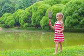 Cute little girl playing badminton on picnic — Foto de Stock