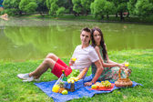 Young couple in love on a picnic outdoors — Stock Photo