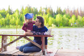Young father and little adorable girl fishing on the river — Foto de Stock