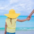 Close up of little girl holding her father hand — Stock Photo #49967625