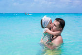 Happy father play with little daughter in perfect sea — Stock Photo