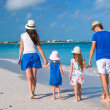 Back view of young family with two kids on caribbean vacation — Stock Photo