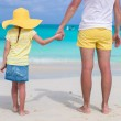 Close up of little girl holding her father hand on the beach — Stock Photo #49978757