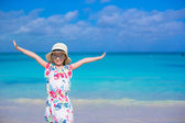 Adorable little girl at white beach during summer vacation — Stock Photo