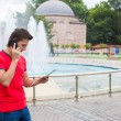 Young businessman using telephone with map in the city — Stock Photo #51207657