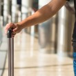 Close-up of a man with luggage in airport while waiting the flight — Stock Photo #51207769