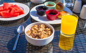 Delicious breakfast with flakes,dried fruit and cup of hot coffee — Stock Photo