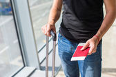 Handing over boarding pass and passport to embark on flight in an airport — Stock Photo
