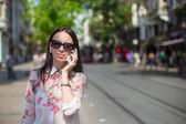 Young beautiful woman talking on her phone — 图库照片