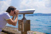Man looking at coin operated binocular on the Bosphorus Strait — Stock Photo