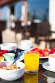 Cacao, juice, muesli and fruits for breakfast at a cafe in the resort — Foto de Stock