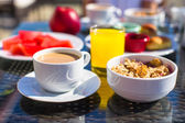 Delicious breakfast with flakes,dried fruit and cup of cacao — Stock Photo