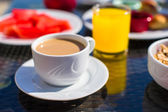 Cacao, juice and fruits for breakfast at a cafe in the resort — Foto de Stock