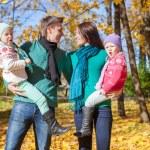 Happy family of four on autumn day — Stock Photo #51313317