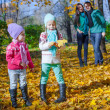 Happy family of four on autumn day — Stock Photo #51313319