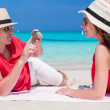 Happy couple taking photo themselves on tropical beach — Stock Photo #51443133