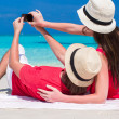 Happy couple taking a photo themselves on tropical beach — Stock Photo #51443427